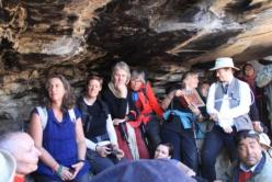 Pilgrims listening to recollections and looking at Jetsunma's photographs of her time in the cave
